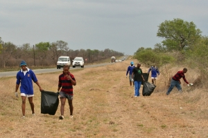 Rugby Team collecting litter at Hlane