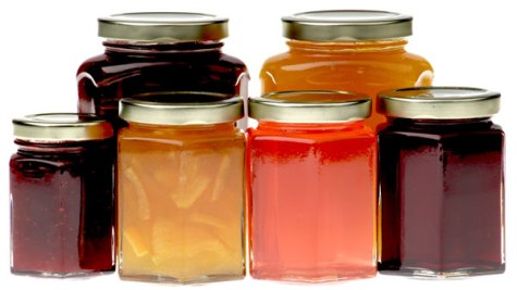 Hexagonal jam jars filled with various jams, marmalades and preserves.